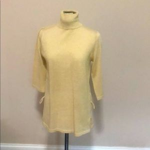 Gold turtleneck blouse